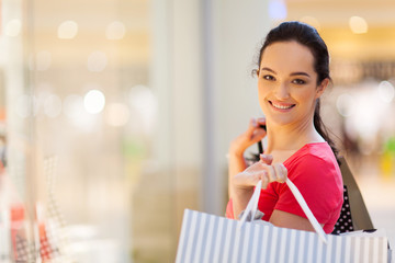 happy young woman shopping in mall