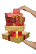 Hand holding stack of giftboxes