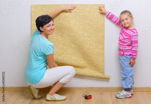 Woman and girl doing home repair