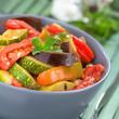 Ratatouille made of eggplant, zucchini, bell pepper and tomato