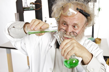 Mad scientist conducts chemistry experiment in his lab