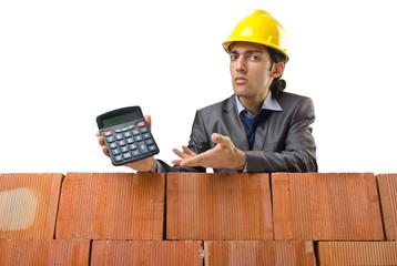 Businessman with bricks on white