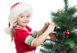 pretty preschool girl decorating Christmas tree isolated on whit