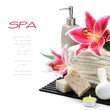 Spa setting with towels, organic soap and lily