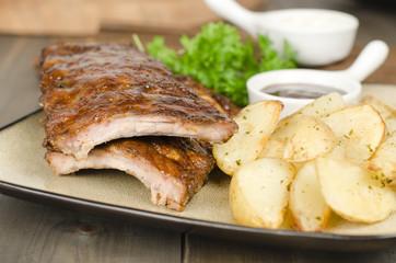 BBQ Ribs - Pork ribs & potato wedges. BBQ sauce & sour cream