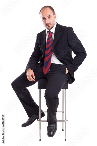Businessman on a stool