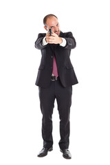 Businessman standing with a gun
