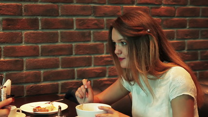 girl eating in a cafe