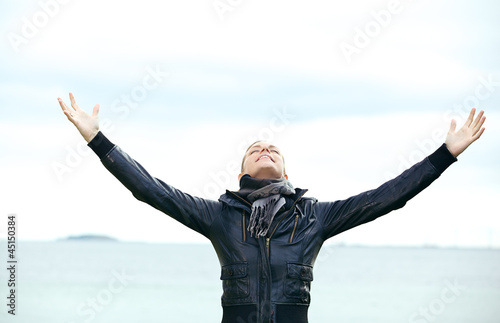 Woman rejoicing with arms outspread