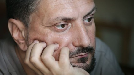 Adult Man in Pensive Mood Looks Forward