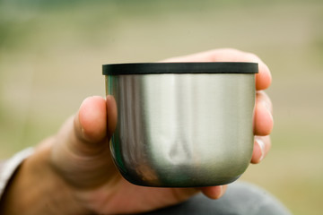 Man drinks tea from a thermos