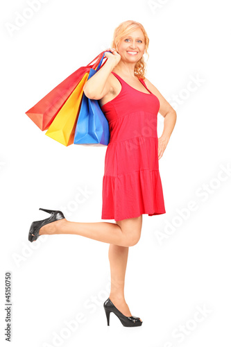 Mature woman holding shopping bags