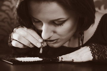 Snorting cocaine lines