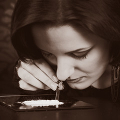 Addicted lady snorting drugs