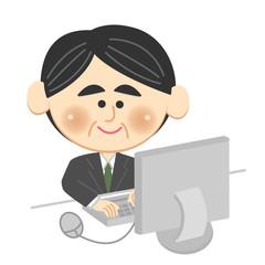 パソコンをするミドルのビジネスマン