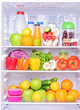 Shot of an open fridge with food products