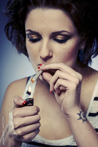 Lady lightting marihuana joint
