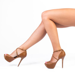 woman legs in brown high heels shoes, studio shot