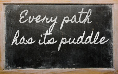 expression -  Every path has its puddle - written on a school bl
