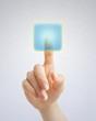 Hand pushing blue button