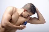 young man shaving the armpit,