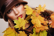 Colorful autumn portrait of beautiful brunette model