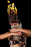 Exotic belly dancer wearing a hijab and fire headdress poster