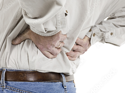 close up image of aged man having back pain
