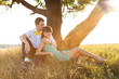 Young couple lying under the tree