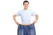A weight loss male showing his old jeans