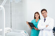 Doctor And Female Assistant In Dental Clinic