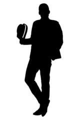 Silhouette of a young man holding a hat