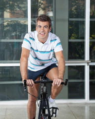 Man Exercising On Spinning Bike