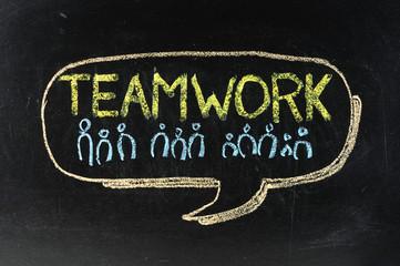 Written by a team on the blackboard chalk