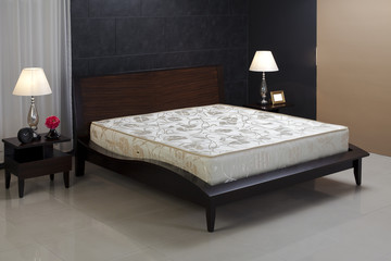 Nice and cozy spring mattress isolated in bedroom