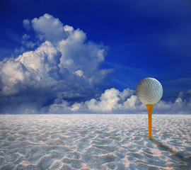 golf ball on yellow tee and and land scape of sand desert