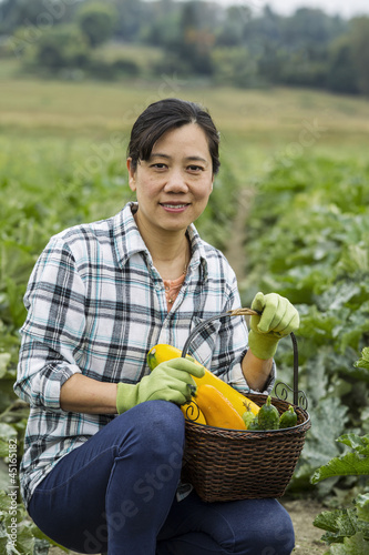 Mature women with Zucchini in Basket