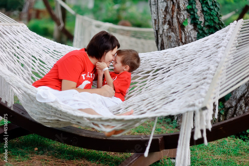 outdoors in a white hammock relax the mother and son in kasnyh s