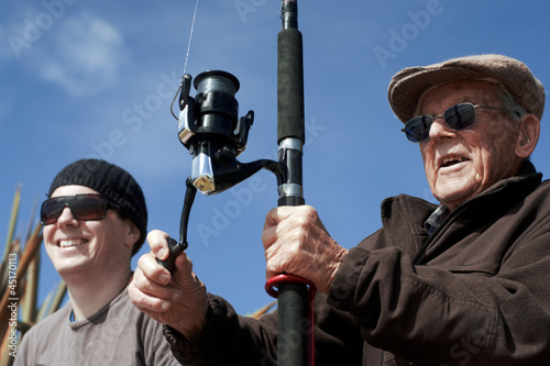 Grandfather and Grandchild fishing together