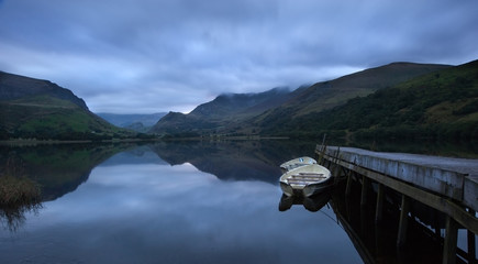 Llyn Nantlle at sunrise looking towards mist shrouded Mount Snow
