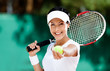 Woman in sportswear serves tennis ball. Tournament