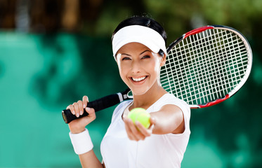 Woman in sportswear serves tennis ball. Tournament