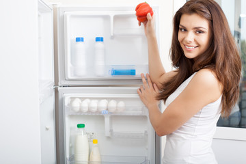 Woman searching in her fridge