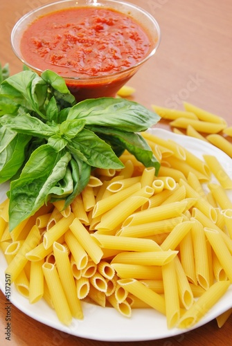 pasta maccaroni tomato and basil leaf
