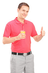 Casual guy holding an orange juice and giving thumb up