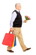Gentleman carrying gifts and bouquet isolated on white backgroun
