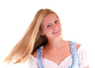 Blondes Mädchen im Dirndl mit fliegenden Haaren