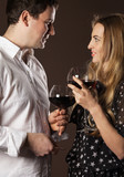 Young happy couple enjoying a glasses of wine