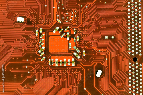 Close up of red computer circuit board