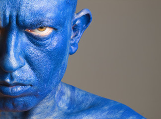 Face man painted of blue color